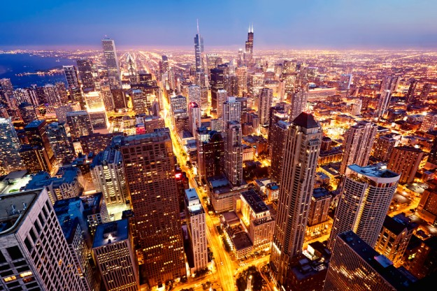 City of Chicago. Aerial view of Chicago downtown at twilight from high above. - via Shutterstock